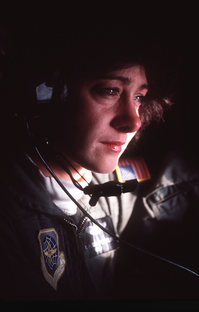 A close-up view of 1ST LT. Julie Gapstur, 109th Aeromedical Evacuation Flight, Minnesota Air National Guard. Gapstur is taking part in exercise Brim Frost '87, a Joint Force-Alaska exercise incorporating units of the Air Force, Army, Navy, Coast Guard, Ai
