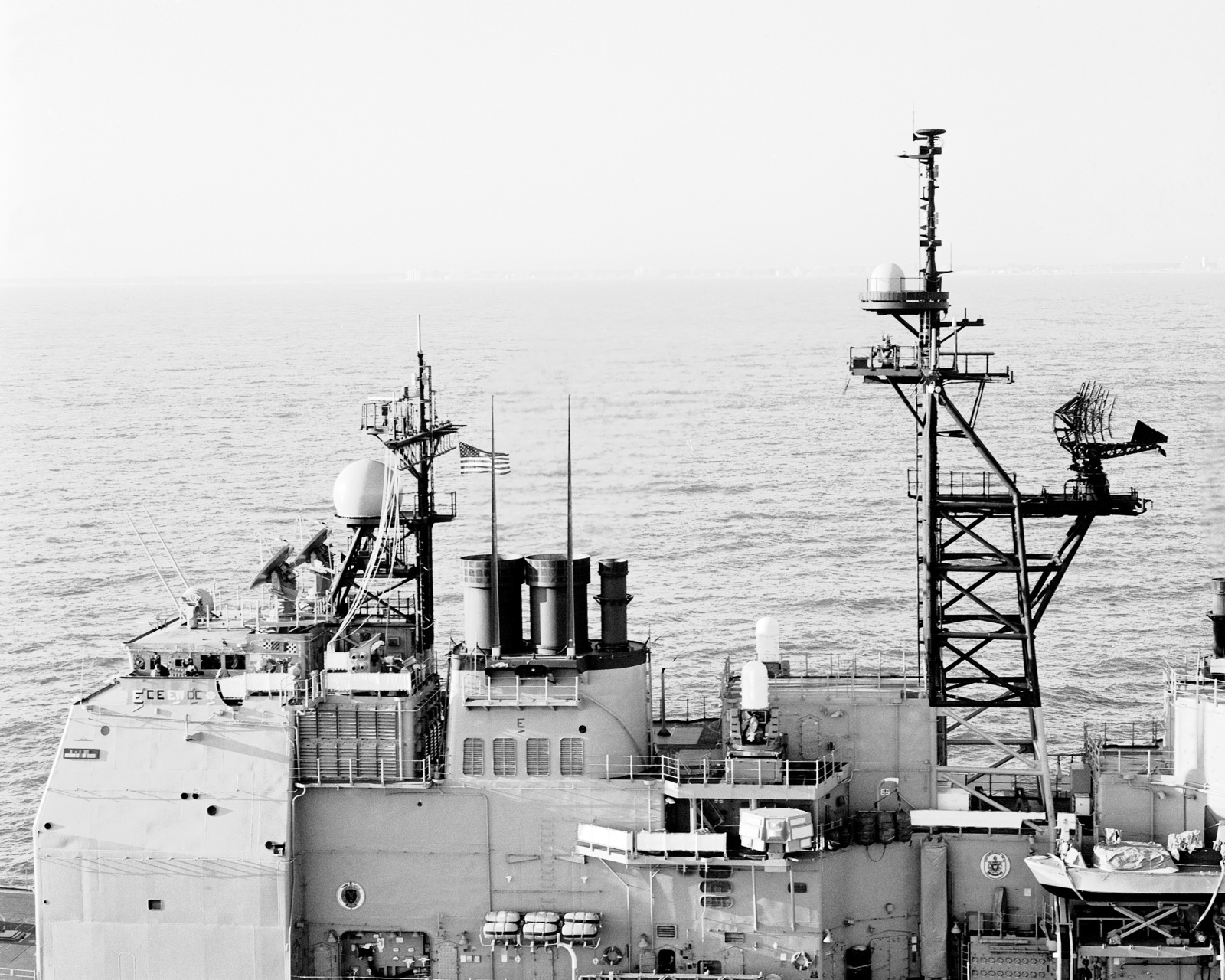A close-up view of the antenna masts and bridge structure aboard the guided missile cruiser USS YORKTOWN (CG 48), as seen from off the ship's port beam