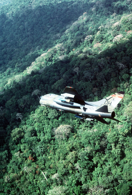 An A-7D Corsair II aircraft from the 178th Tactical Fighter Group, Ohio Air National Guard, banks to the right over the Panamanian jungle during Operation Coronet Cove