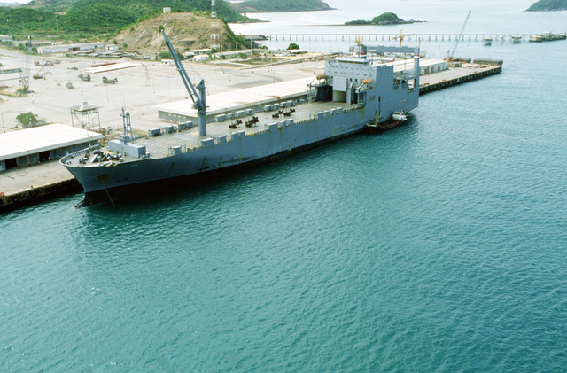 An aerial view of the Military Sealift Command vehicle cargo ship CAPE HORN (T-AKR-5068) as it lies tied up during the combined Thai/U.S. Exercise Cobra Gold '89