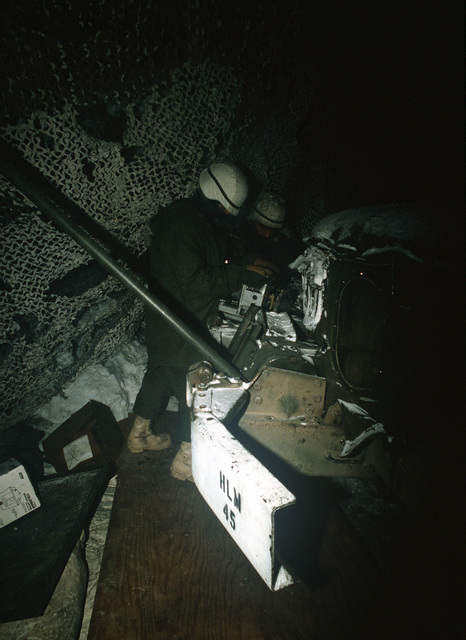 Members of the 706th Maintenance Battalion use a Swing Fire heating device to warm the engine block of an M35 series 2.5-ton truck during Exercise BRIM FROST '89