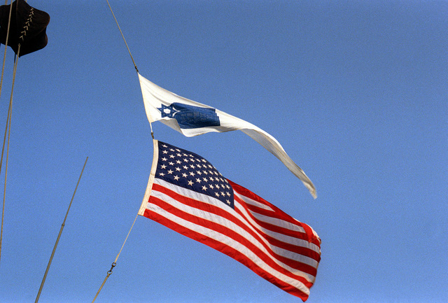The pennant of the Jewish Chaplain Corps flies above the national ensign aboard the nuclear-powered aircraft carrier USS DWIGHT D. EISENHOWER (CVN-69) during Passover services