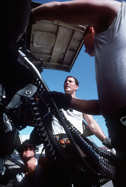 Weapons crew members from the 178th Tactical Fighter Group, Ohio Air National Guard, load 20mm ammunition into an A-7D Corsair II aircraft during Operation Coronet Cove