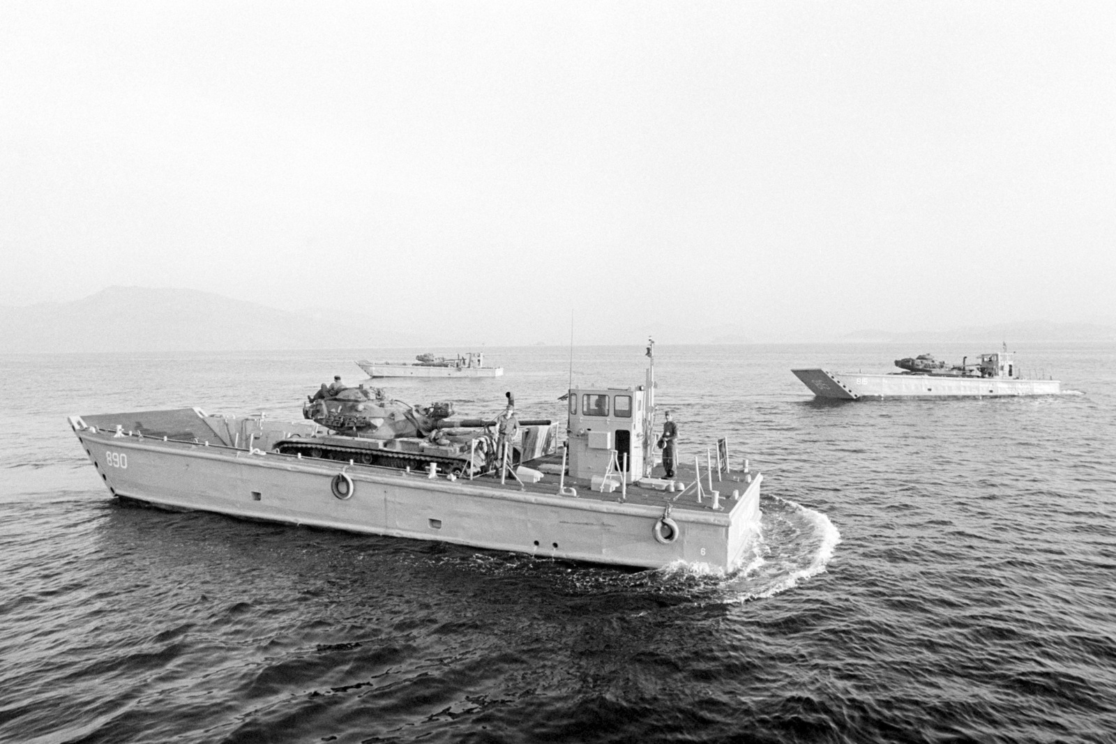 M60 main battle tanks are transported aboard LCM 8 mechanized landing craft during an amphibious assault exercise