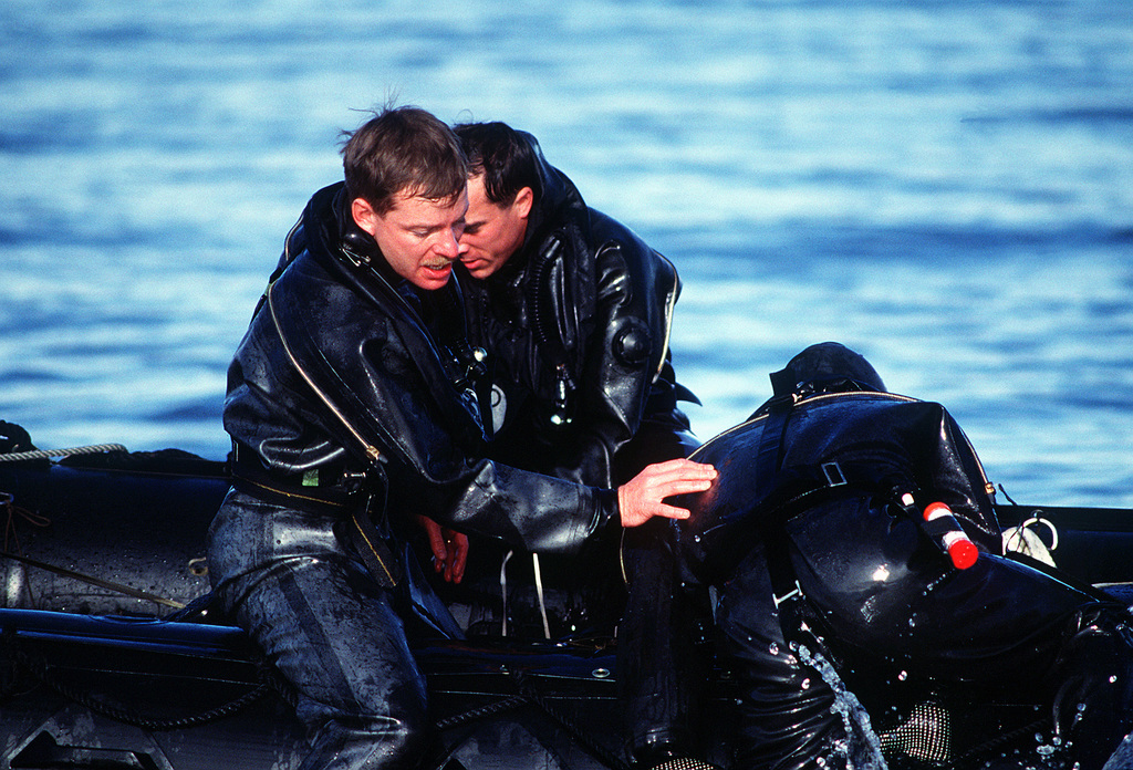 A member of an Army Special Forces team helps his partners aboard a Zodiac raft during Jaguar Bite '89, a joint Army-Air Force exercise conducted by the U.S. Special Operations Command