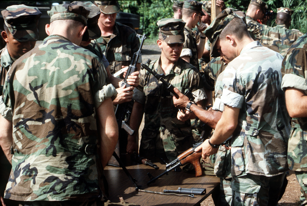 Marines disassemble and examine several Soviet-made AK-47 and AKM assault rifles during a weapons familiarization class