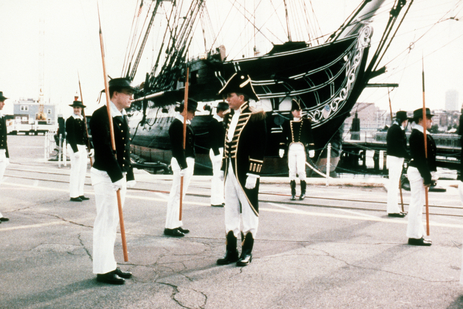 "CMDR. David Cashman, the 62nd commanding officer of the 44-gun sailing frigate USS CONSTITUTION, inspects AIRMAN Leo Capelette, a member of the ship's marching unit called the ""Pikemen."" The unit will be appearing in President-elect George Bush's Inaugural Parade"