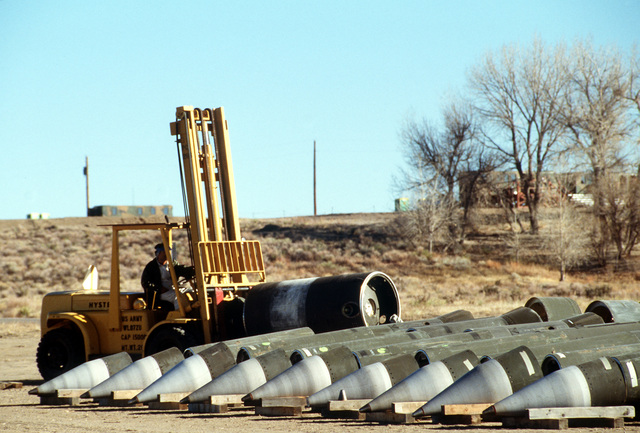 A depot employee uses a forklift to move a section of a Pershing II missile. Several missiles are being destroyed in the presence of Soviet inspectors in accordance with the Intermediate-Range Nuclear Forces (INF) Treaty