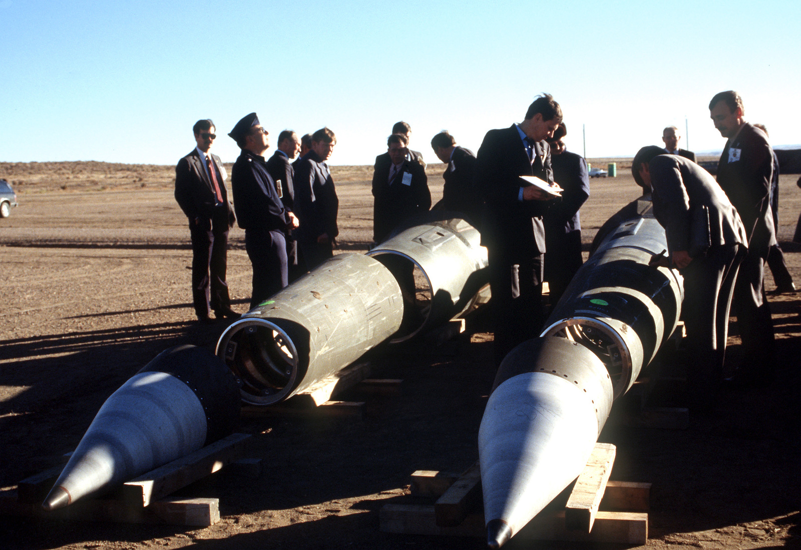 With their American escorts watching, Soviet inspectors record data from the side of a Pershing II missile prior to its destruction. Several missiles are to be destroyed in accordance with the Intermediate-Range Nuclear Forces (INF) Treaty
