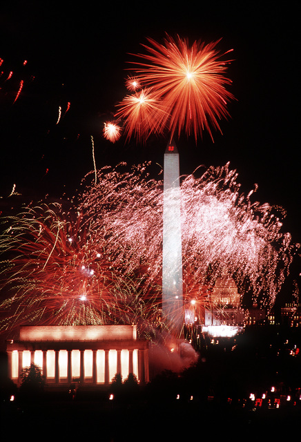Fireworks provide the backdrop for the Lincoln Memorial, Washington Monument and U.S. Capitol during the opening inaugural ceremonies in honor of George H.W. Bush, 41st president of the United States