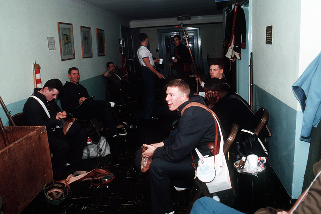 Participants in the Presidential Pageant wait backstage during the performance being held in honor of George H.W. Bush, 41st president of the United States