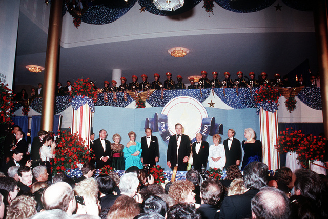 President George H.W. Bush, 41st president of the United States, and his family join Bob Hope on the stage during an inaugural event