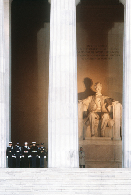 The statue of Abraham Lincoln overshadows the Joint Ceremonial Honor Guard during the inaugural opening ceremonies at the Lincoln Memorial in honor of George H.W. Bush, 41st president of the United States
