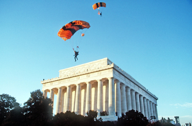 US Army Golden Knights Parachute Team members perform during Inauguration Day opening ceremony held at Lincoln Memorial in honor of George H.W. Bush, 41st president of the United States