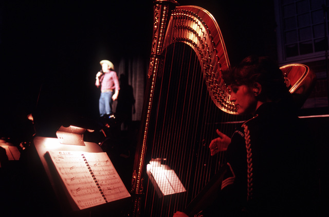 A U.S. Navy Band harpist performs during the American Presidential Pageant being held in honor of George H.W. Bush, 41st president of the United States