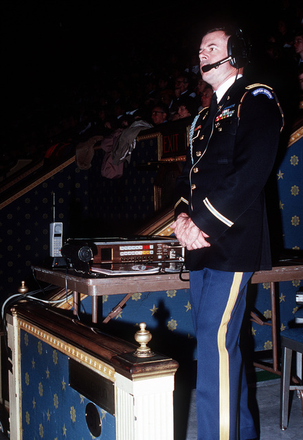 An officer of the 3rd Infantry (The Old Guard) monitors a communications system at Constitution Hall during the American Presidential Pageant being held in honor of George H.W. Bush, 41st president of the United States