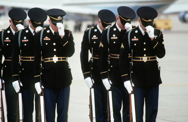Members of the Third Infantry (The Old Guard) straighten their hats prior to the departure ceremony for former President Ronald W. Reagan