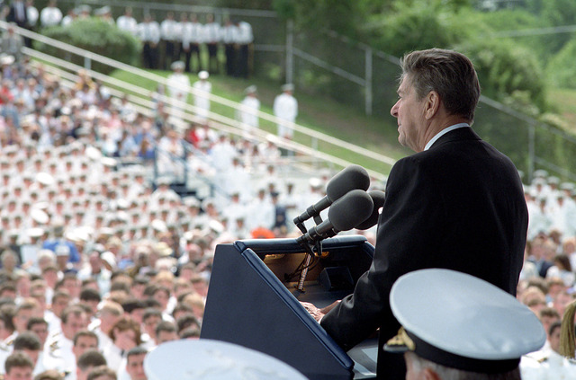 President Ronald Reagan Addressing the 1985 Graduating Class of the United States Naval Academy, Presenting Diplomas with Nancy Reagan and John Lehman United States Naval Academy Stadium in Annapolis, Maryland