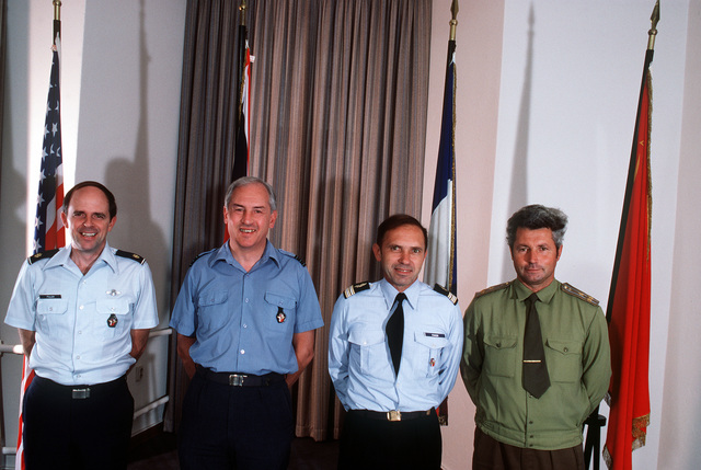 Pictured at the Berlin Air Safety Center (BASC) are, left to right: MAJ. Rick Fuller, U.S. Air Force; David Pollock, British wing commander; COL. Claude Favier, French representative and COL. Boris Shunin, Soviet representative. The men are part of a 36-m