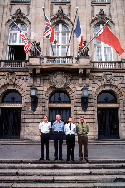 Pictured outside the Berlin Air Safety Center (BASC) are, left to right: MAJ. Rick Fuller, U.S. Air Force; David Pollock, British wing commander; COL. Claude Favier, French representative and COL. Boris Shunin, Soviet representative. The men are part of a