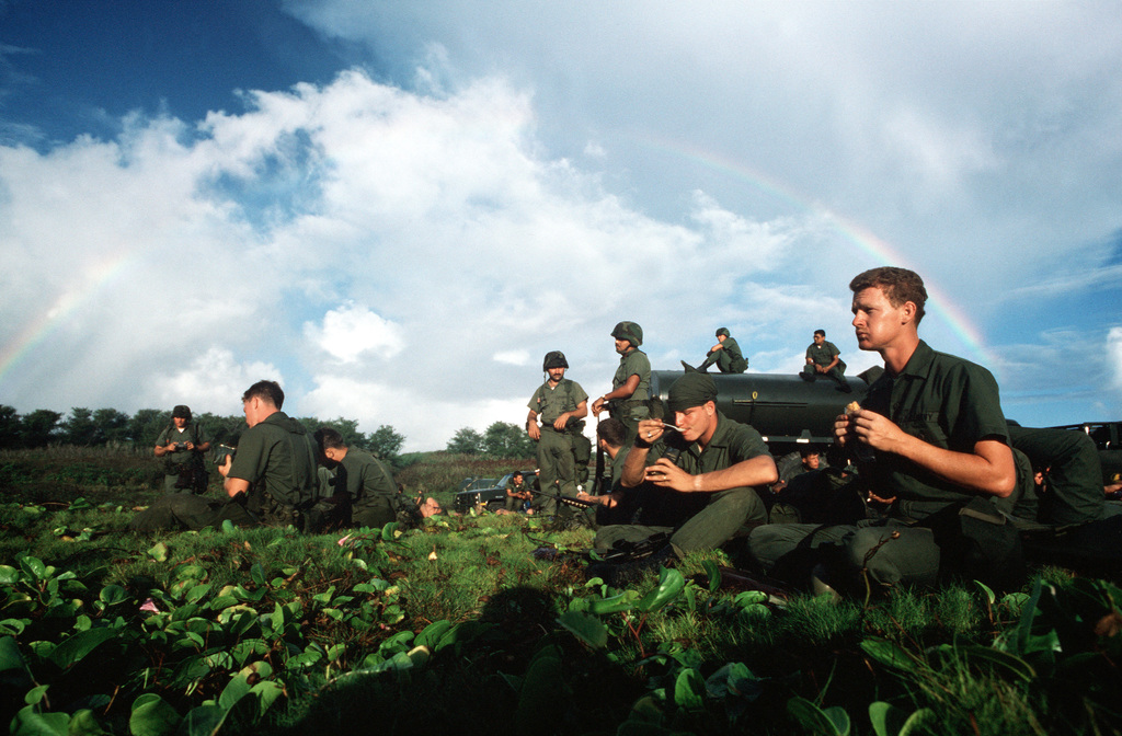 Seabees from Naval Mobile Construction Battalion 3 (NMCB-3) take a meal break at the firing range during Exercise Kennel Bear '89