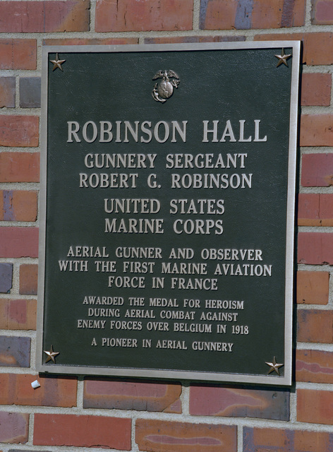 A plaque on the wall of Robinson Hall explains the history of the hall's namesake, GUNNERY Sergeant (GYSGT) Robert G. Robinson