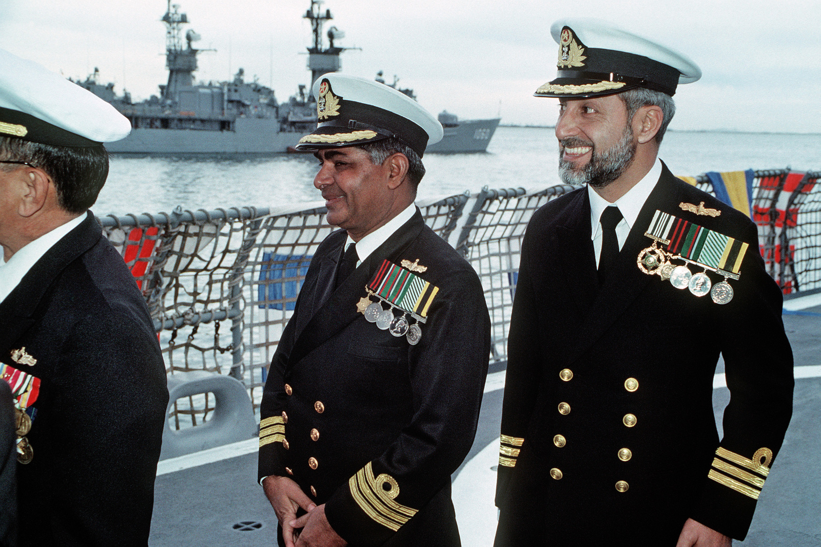 Pakistani naval officers arrive for the ceremony during which former US Navy ships, the Guided Missile Frigate USS BROOKE (FFG 1) and the Frigate USS O'CALLAHAN (FF 1051), will be transferred to the Pakistani navy.  The BROOKE will be commissioned as PNS KHAIBAR (D 163) while the O'CALLAHAN will become PNS ASLAT (F 265)
