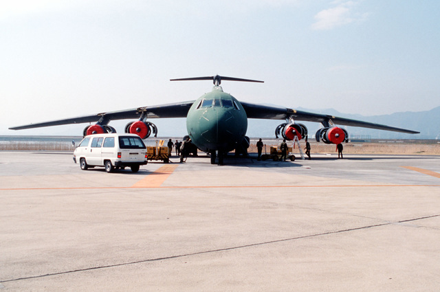 Personnel from the 2955th Combat Logistics Support Squadron, the 63rd Field Maintenance Squadron and the 63rd Avionics Maintenance Squadron use an NC-10B mobile electric powerplant, left, and an engine starter unit, right, to ready a 63rd Military Airlift Wing C-141B Starlifter aircraft for testing. The Starlifter, which was badly damaged during a landing mishap in January 1987, is undergoing the final stages of repair before its eventual return to the United States