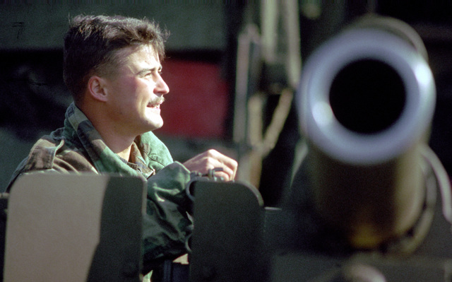 A Marine artilleryman performs preventive maintenance on one of his battery's weapons prior to an amphibious landing that will be part of the joint U.S./South Korean exercise Team Spirit '89. Exact Date Shot Unknown
