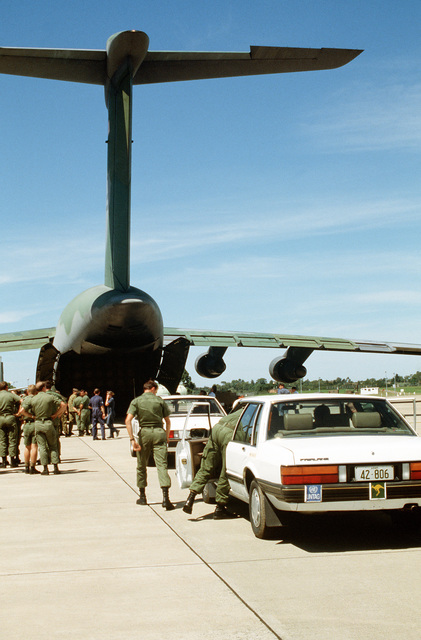 A 60th Military Airlift Wing C-5A Galaxy aircraft, part of operation Election District, takes on a contingent of Australians to join Headquarters Civil Engineers United Nations Transition Assistance Group (HQ CE UNTAG). The engineers will construct facilities for UNTAG, which will perform peacekeeping duties and monitor the November 1989 elections and independence of Namibia