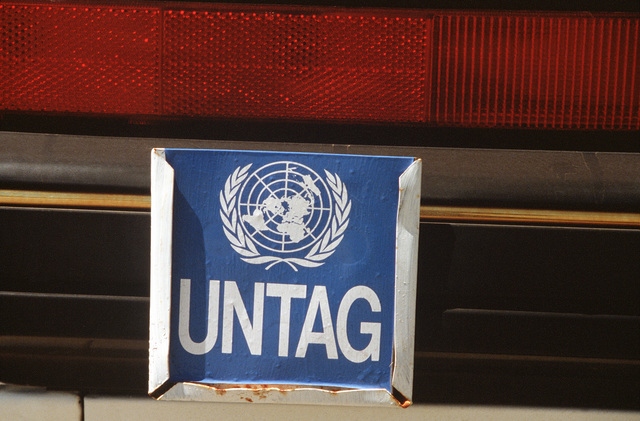 A close-up view of a United Nations Transition Assistance Group (UNTAG) plate on a vehicle bound for Namibia. As part of operation Election District, a U.S. 60th Military Airlift Wing C-5A Galaxy aircraft is transporting a contingent of Australian military engineers to assist UNTAG peacekeeping forces in preparation for the November 1989 elections and independence of Namibia