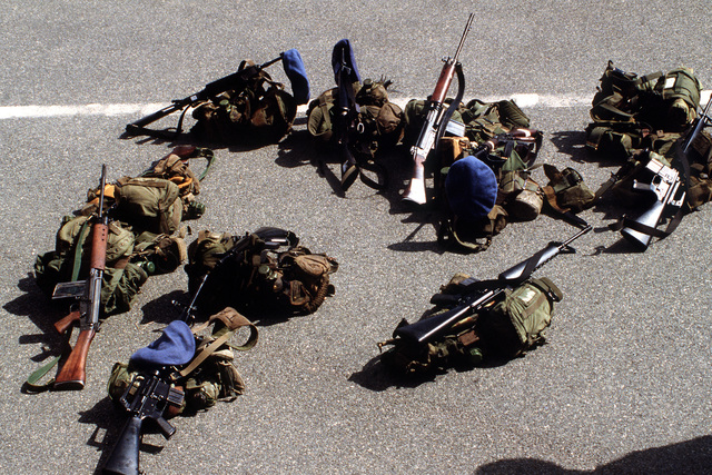 Australian L-1A1 and M-16A1 rifles lie on the ground with the gear of Australian troops serving in the United Nations Transition Assistance Group (UNTAG) during operation ELECTION DISTRICT. UNTAG will perform peacekeeping duties and monitor the November 1989 elections and independence of Namibia