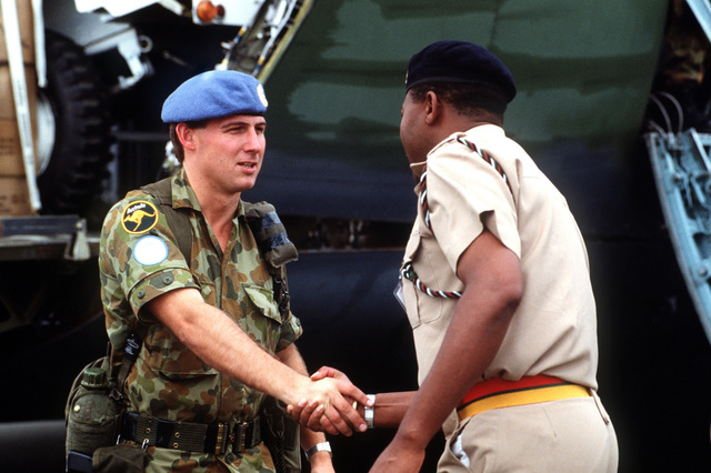 Kenyan Lieutenant Colonel Frank Mwangangi, military assistant to the United Nations Transition Assistance Group (UNTAG) General Forces Commander, greets a member of the Royal Australian Engineers District. UNTAG will perform peacekeeping duties and monitor the November 1989 elections and independence of Namibia