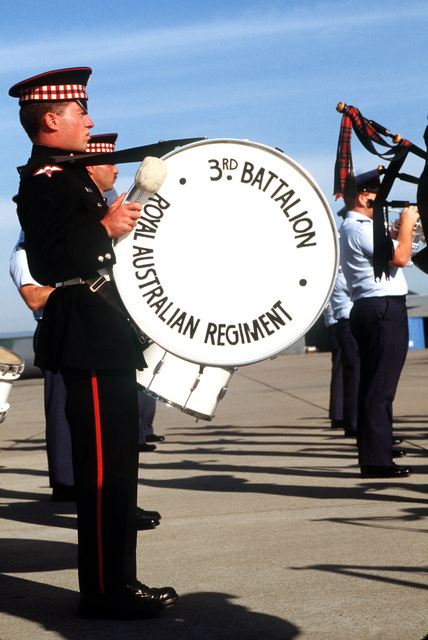 The Royal Australian Regiment 3rd Battalion band plays a sendoff for a United Nations Transition Assistance Group (UNTAG) contingent of Royal Australian Engineers during operation ELECTION DISTRICT. UNTAG will perform peacekeeping duties and monitor the November 1989 elections and independence of Namibia