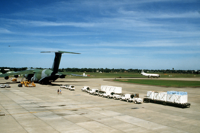 United Nations Transition Assistance Group (UNTAG) is loaded into a US 60th Military Airlift Wing C-5A Galaxy aircraft during operation ELECTION DISTRICT. The C-5 is transporting a contingent of Royal Australian Engineers to assist UNTAG peacekeeping forces in preparation for the November 1989 elections and independence of Namibia