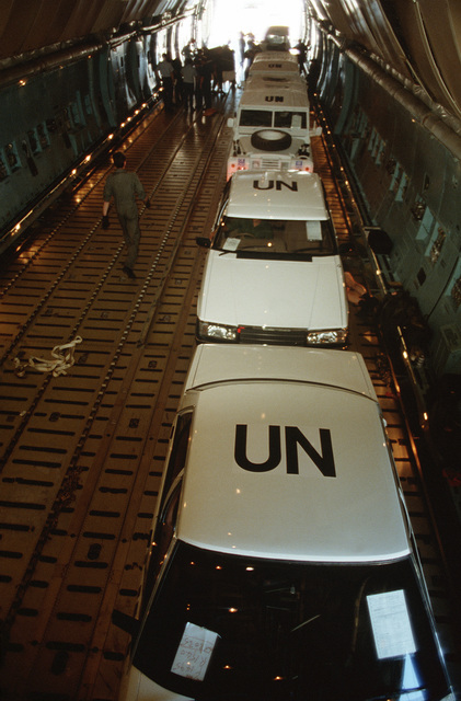 United Nations Transition Assistance Group (UNTAG) Land Rover and other vehicles are loaded into a US 60th Military Airlift Wing C-5A Galaxy aircraft during operation ELECTION DISTRICT. The C-5 is transporting a contingent of Royal Australian Engineers to assist UNTAG peacekeeping forces in preparation for the November 1989 elections and independence of Namibia