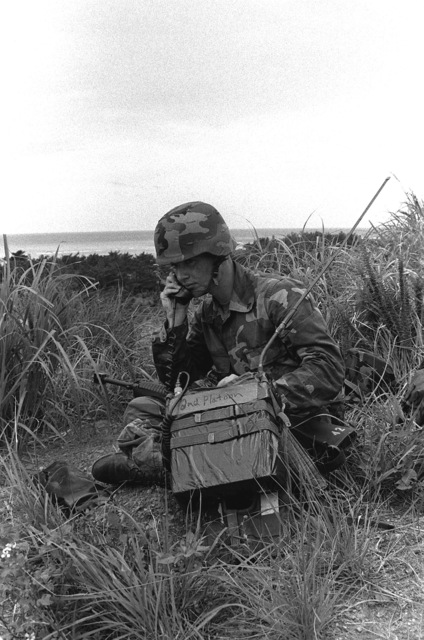 A Marine from the 9th Expeditionary Brigade maintains communications during a field operation