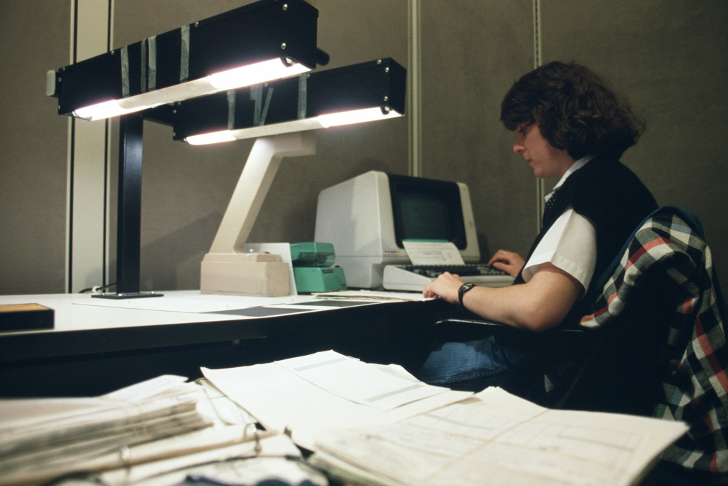 Data transcriber Kathy L. Warfield copies original documents to microfiche at the Air Force Accounting and Finance Center