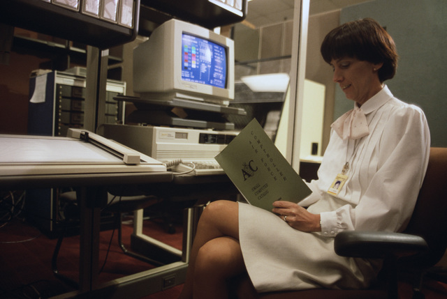 Finance systems specialist Penny Vincent tests field developed software for the Zenith 248 microcomputer at the Air Force Accounting and Finance Center