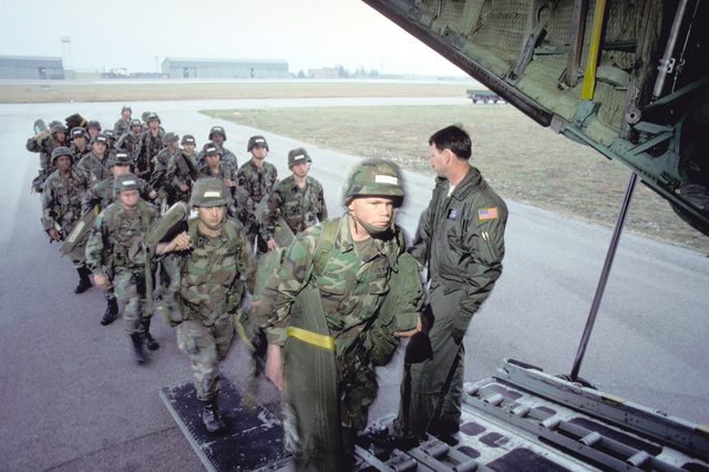 Paratroopers of the Airborne Combat Team, 3rd Battalion, 325th Infantry Division board and C-130E Hercules aircraft of the 37th Tactical Airlift Squadron. Their airdrop over West Germany is part of an Army training and evaluation program (ARTEP) mission