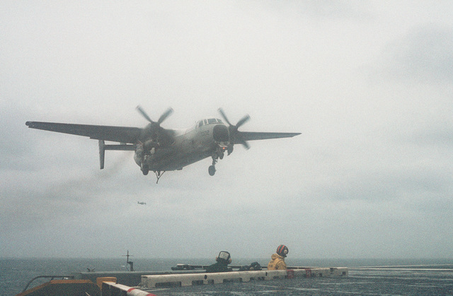 An Airborne Early Warning Squadron 120 (VAW-120) C-2A Greyhound aircraft comes in for an arrested landing on the flight deck of the nuclear-powered aircraft carrier USS DWIGHT D. EISENHOWER (CVN 69) during carrier qualifications off the Virginia Capes