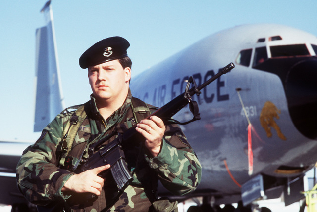 SGT Reed E. Reichardt, 91st Missile Security Squadron, guards a KC-135 Stratofortress aircraft during the Strategic Air Command exercise Giant Warrior '89. Reichardt is armed with an M-16 rifle