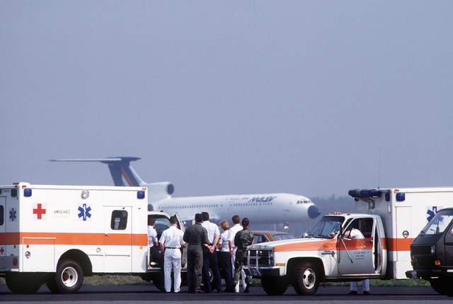 Air Force ambulances and security personnel wait for clearance to approach the hijacked Tu-154B Hungarian commercial aircraft that is parked on the civilian side of Frankfurt International Airport. The Soviet-built aircraft, which was not granted permission to land on the military side of the airport at Rhein-Main Air Base, was hijacked by two teenage Czechoslovakians who were later apprehended. No one was injured in the incident
