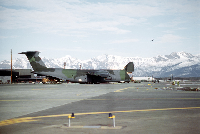 A view of a 3rd Military Airlift Squadron C-5B Galaxy aircraft as it is unloaded by members of the 616th Aerial Port Squadron. The aircraft brought equipment that will be used in the cleanup of the oil spilled by the tanker Exxon Valdez in Price William Sound