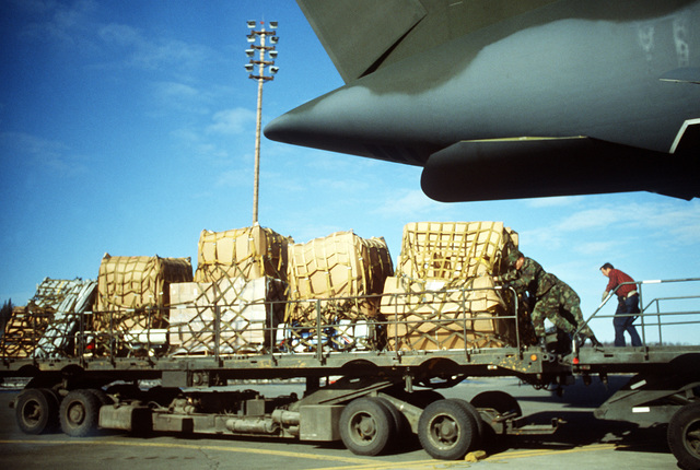 Members of the 616th Aerial Port Squadron push a pallet of equipment from the cargo area of a 3rd Military Airlift Squadron C-5B Galaxy aircraft onto a K-Loader. The equipment will be used in the cleanup of the oil spilled by the tanker EXXON VALDEZ in Prince William Sound
