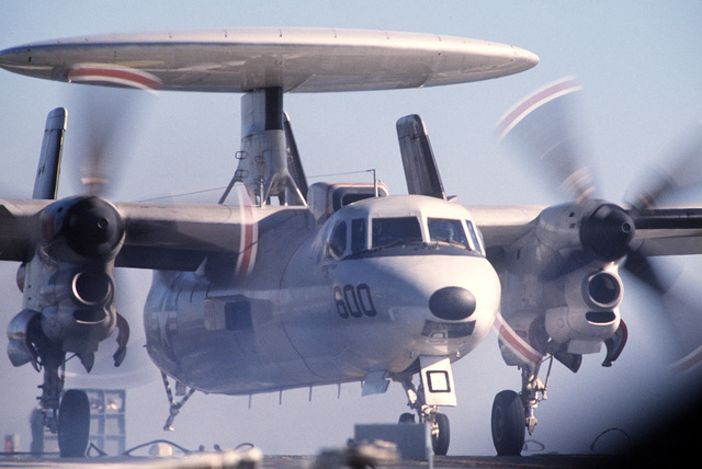 Close-up of an E-2C Hawkeye aircraft touching down on the deck of the USS INDEPENDENCE (CV-62) during carrier qualifications of Reserve Carrier Air Wing 30 (CVWR-30) off the coast of Southern California. (last in a series of 5)