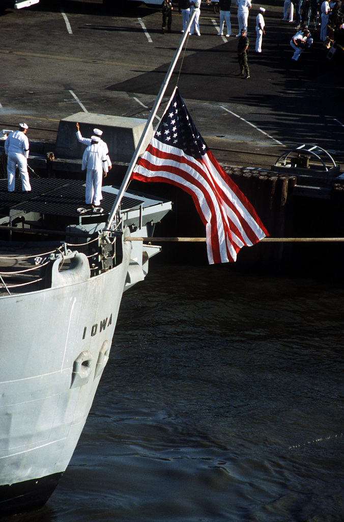 The American flag flies at half mast from the stern of the battleship USS Iowa (BB-61) as the ship returns to home port following an exposion which killed 47 crew members. The explosion occurred inthe No. 2 16-inch gun turret as the Iowa was conducting routine gunnery exercises approximately 300 miles northeast of Puerto Rico on April 19th