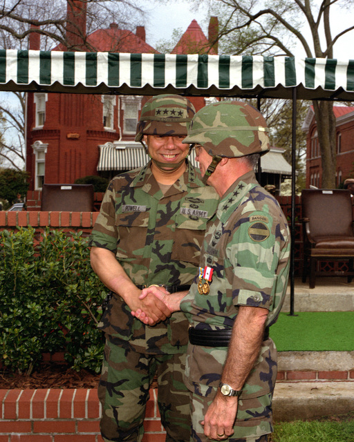 GEN. Colin L. Powell shakes hands with GEN. Joseph T. Palastra after Forces Command (FORSCOM) change of command in which GEN. Powell took command from GEN. Palastra