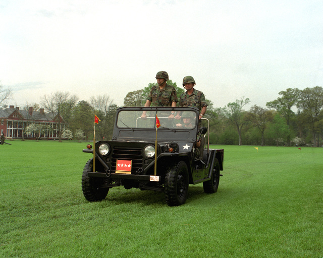 General Colin L. Powell and GEN. Joseph T. Palastra, Jr. complete ceremonial inspection of troops in a Jeep at the Forces Command (FORSCOM) change of command ceremony where GEN. Powell became new Commander in CHIEF. The Jeep is driven by PFC Grauel