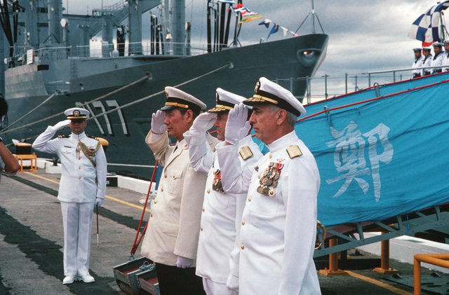 Vice Admiral (VADM) Ma Xin Chun, Commander of the Chinese North Sea Fleet, 2nd from left, Admiral (ADM) David Jeremiah, Commander-in-CHIEF, US Pacific Fleet, (center), and VADM James Dorsey Jr., Commander, US Third Fleet, salute at ceremonies of the visiting Chinese training ship ZHENG HE